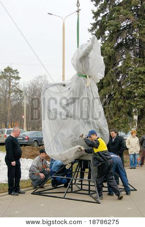 MOSCOW - APRIL 07: Workers unwrap statue of Yuri Gagarin  on April 07, 2011 in Moscow, Russia. Yuri Gagarin is the first Russian cosmonaut.