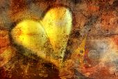 golden Valentine heart on grunge background