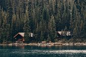 Lake Ohara with waterfront cabin, Yohu National Park, Canada. poster