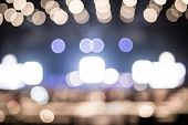 Blurred Background : Bokeh Lighting In Concert With Audience ,music Showbiz Concept poster
