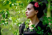 Youth, Beauty. Girl With Flower In Hair In Green Leaves poster