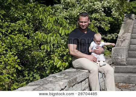 baby boy with father green background