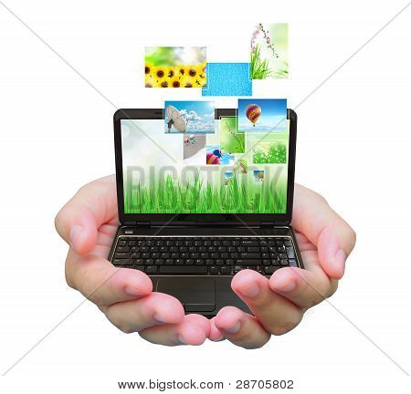 laptop PC and streaming images virtual buttons on women hand