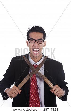 Stressed Businessman With Scissor