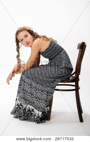 Portrait Of A Pretty Young Girl With With Long Curly Hairs