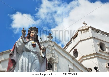 Jesus Statue In Front Of A Church