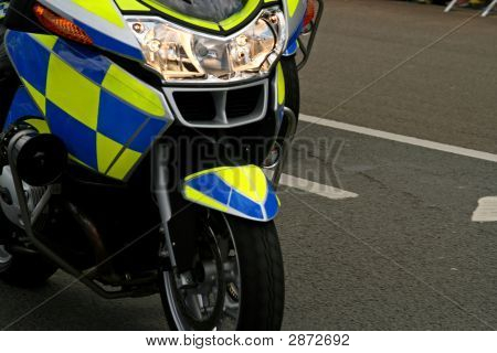 Front Headlight Of Speeding Police Motor Bike