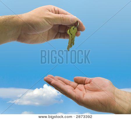 Hands And Keys On Sky