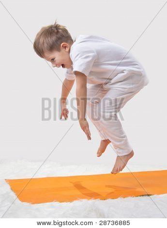 Kid Jumps, Doing Yoga