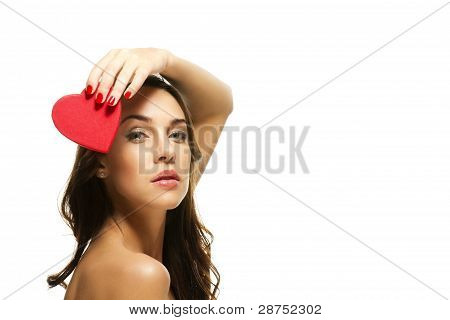 beautiful woman holding red heart over her head