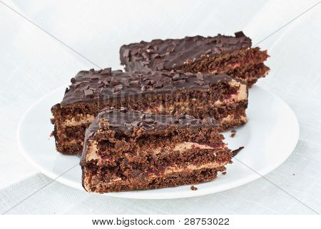Three pieces of chocolate cake