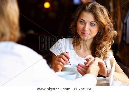 Young pretty woman sitting in restaurant