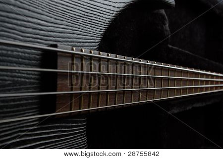 Bass guitar on the black