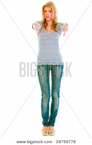 Full Length Portrait Of Shocked Teen Girl Showing  Thumbs Up Gesture
