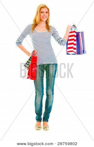 Full Length Portrait Of Happy Teen Girl With Shopping Bags