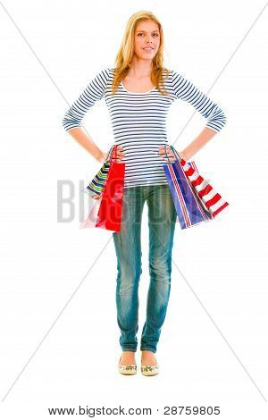 Full Length Portrait Of Smiling Teen Girl With Shopping Bags