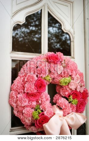 An Image Of Church Doors With Wedding Flowers On It