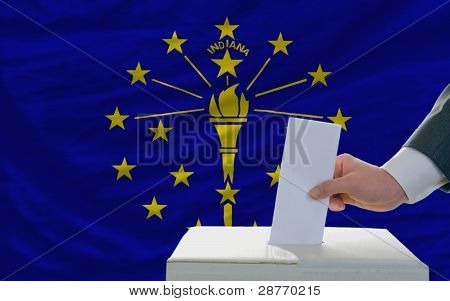 Man Voting On Elections In Front Of Flag Us State Flag Of Indiana