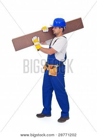 Handyman Or Worker Carrying Wooden Laminate Flooring