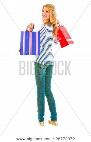 Smiling Teen Girl With Shopping Bags Looking Back