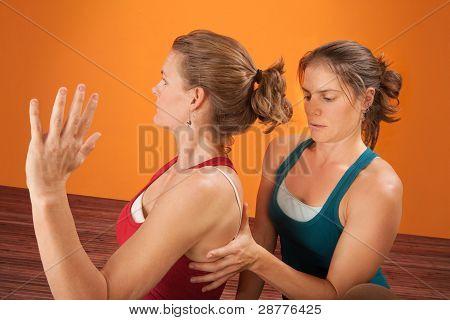 Trainer Checks Shoulder Blade