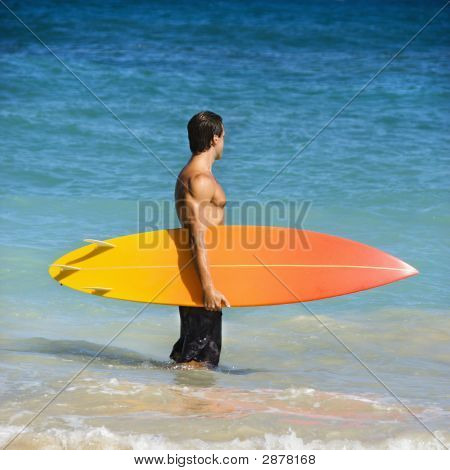 Man With Surfboard.