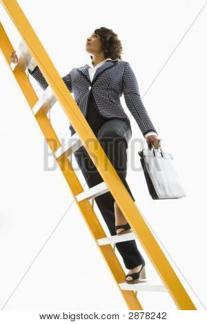 Businesswoman Climbing Ladder.