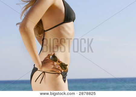 Young Beautiful Girl On Blue Sky Background