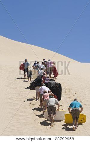 Climbing A Huge Sand Dune