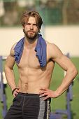 Taking Minute Break. Man Athlete With Shirt On Shoulders After Training Outdoor. Athletic Man Relaxi poster