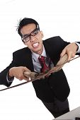 Angry Businessman With Scissors