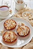 Close-up Of Lemon Meringue Mini Pies With Browned Meringue Peaks Served With Tea, Mini Marshmallows  poster