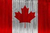 Canada Flag Painted On Old Wood Plank. Patriotic Background. National Flag Of Canada poster