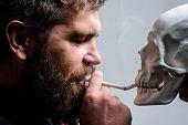 Man Smoking Cigarette Near Human Skull Symbol Death. Nicotine Destroy Health. Harmful Habits. Smokin poster