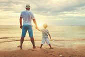 Happy Fathers Day. Family Dad And Child Son At Sea Beach poster
