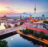 Berlin, Germany at sunset. Red City Hall, Television Tower. European capital cities. poster