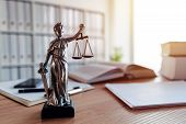 Lady Justice Statue In Law Firm Attorney Office, Blindfolded Justitia With Balance Scales And Sword  poster