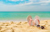 Pink And White Sandals, Sunglasses On Sand Beach At Seaside. Casual Fashion Style Flipflop And Glass poster