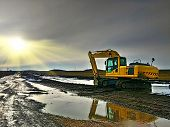 A Large Construction Excavator Of Yellow Color On The Construction Site In A Quarry For Quarrying. D poster
