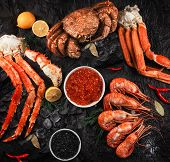 Set of seafood: red and black caviar, limb of hairy crab, limb of snow crab, far eastern kamchatka c poster