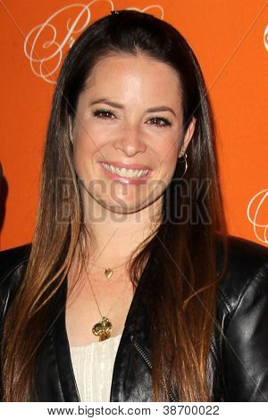 "LOS ANGELES - OCT 16:  Holly Marie Combs arrives at  ""Pretty Little Liars"" Special Halloween Episode Screening at Hollywood Forever Cemetery on October 16, 2012 in Los Angeles, CA"