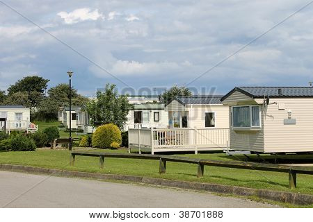 Scenic view of caravan trailer park with road in foreground.