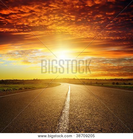 red sunset over road