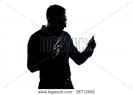 one caucasian man salute gesture telephone videophone  portrait silhouette in studio isolated white background