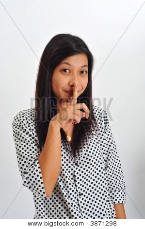 Young Asian With Finger On Her Lips