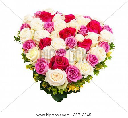 Beautiful ornamental wreath in the shape of heart made of natural multicolored roses isolated on white