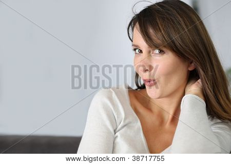 Attractive woman with embarrassed look