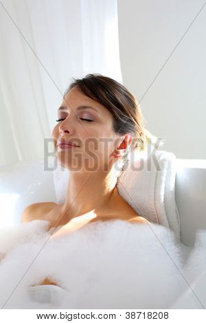 Beautiful woman relaxing in bathtub