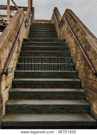 Concrete steps over a railway bridge