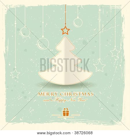 Simple paper Christmas tree with star and hanging ornaments on pale green distressed background.